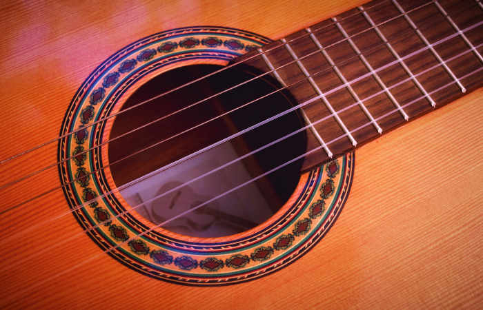 close-up-of-strings-on-an-acoustic-guitar