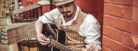 man-playing-guitar-on-stoop