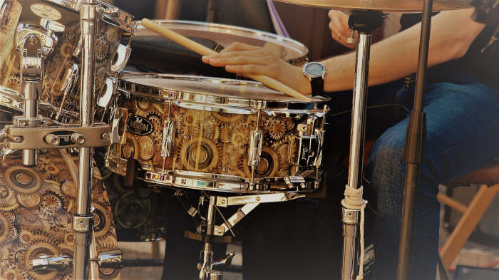 Closeup of a man playing a snare drum