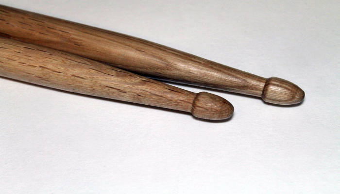 closeup of a pair of wood-tipped drum sticks