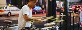 Man playing drums on Hong Kong street
