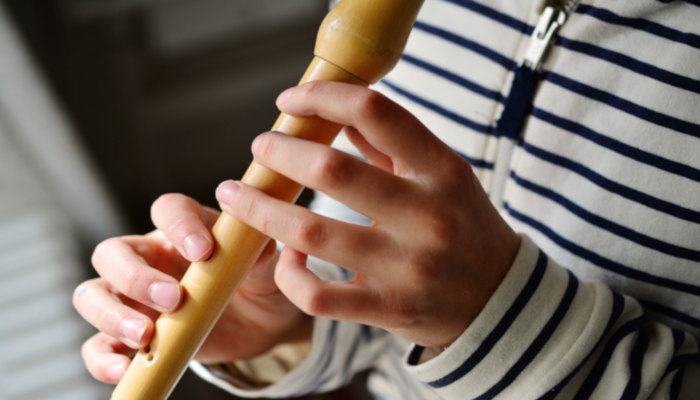 student-playing-recorder