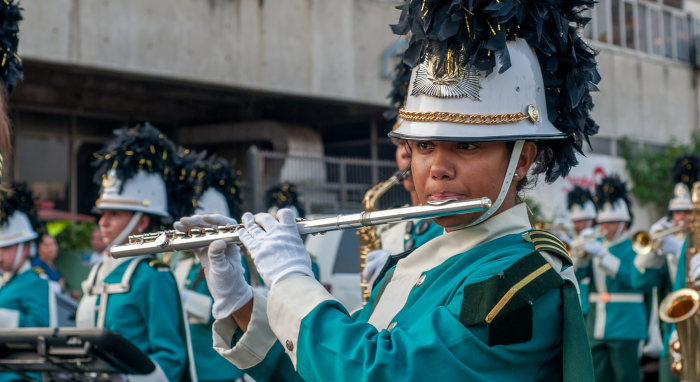 woman-playing-flute-in-marching-band