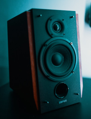 Black studio monitor speaker on black table