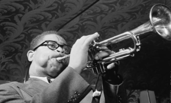 Black and white photo of famed trumpeter Dizzie Gillespie playing his horn