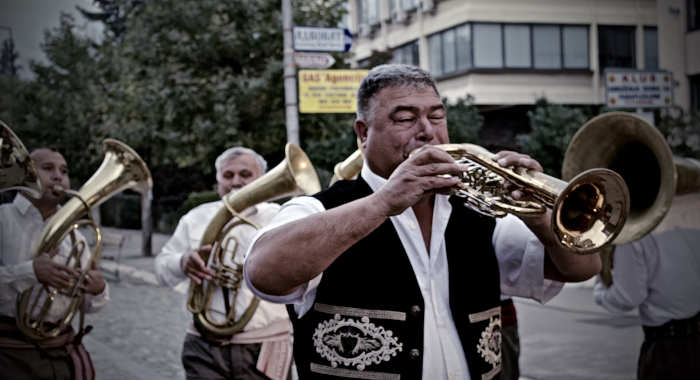 A European brass band playing music in the street