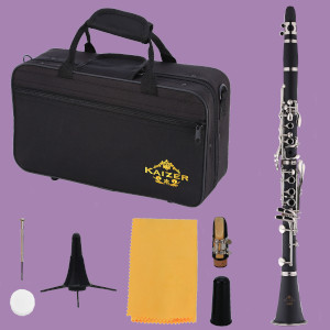 Kaizer B flat clarinet with case and accessories on purple background
