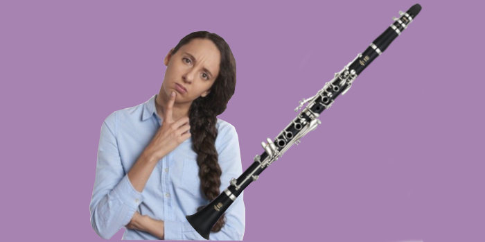 Yamaha YCL-255 clarinet with woman looking confused on purple background