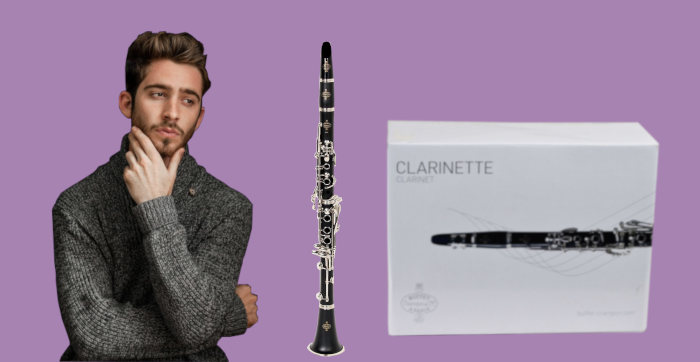 Bearded man looking pensively at Buffet B12 clarinet with box on purple background
