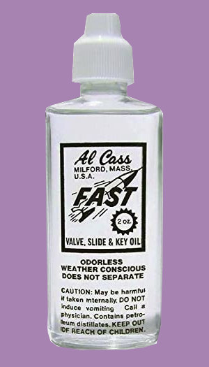 Bottle of Al Cass valve oil on purple background