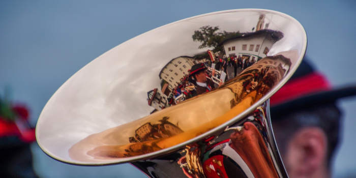 A brass band reflected in a trumpet bell